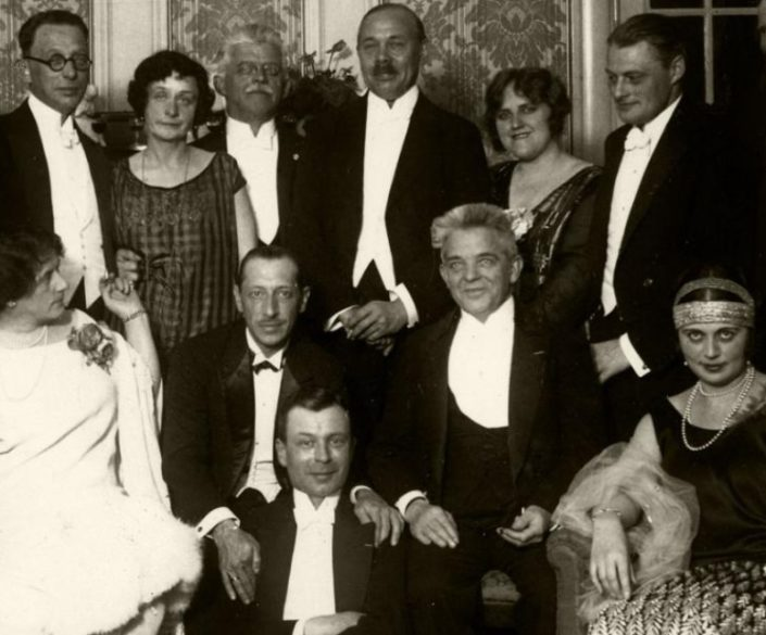 The Danish composer Carl Nielsen at a party for Igor Stravinsky sitting by his side