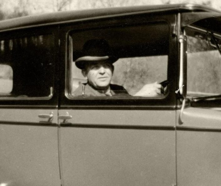 The Danish composer Carl Nielsen in his Morris car