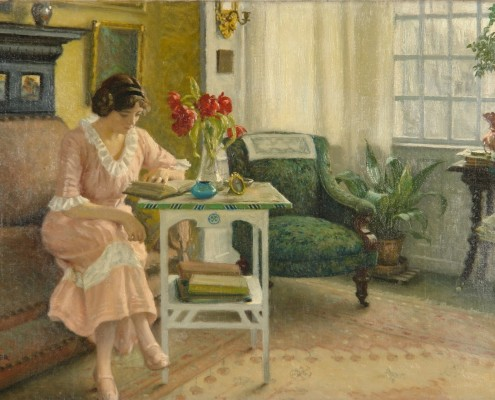 Paul Fischer. The artist's wife Musse reading at home in Sofievej