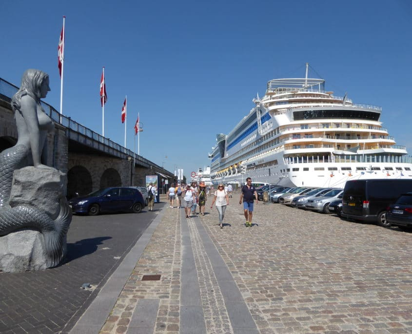 Cruise ship and modern mermaid at Langelinie Pier, Copenhagen, Denmark