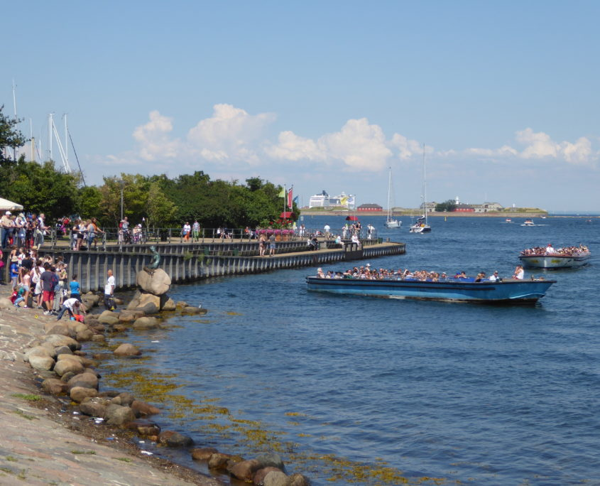 Tour boats and tourists at The Little Mermaid, Copenhagen, Denmark